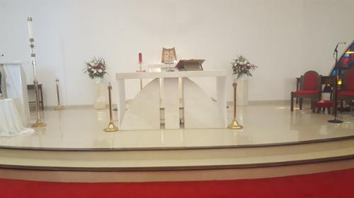Sullivan & Son installed both the curved marble altar and the broadloom carpet.