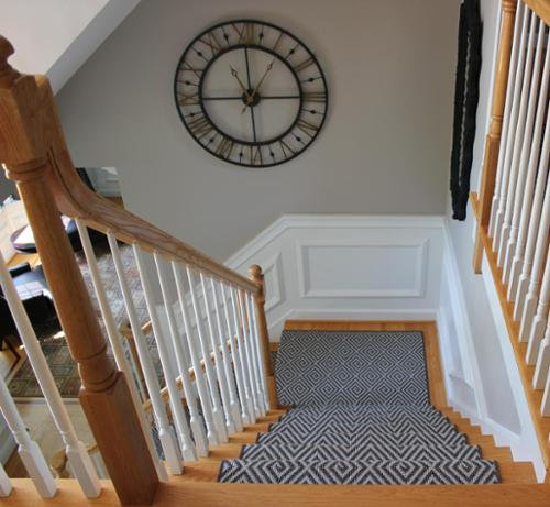 This home features Kane's Decor Line for the stair runner and front door mat as well as two custom contoured area rugs that follow the lines of the wood inlay border.